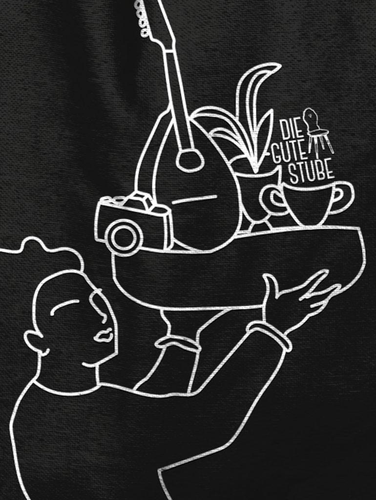 Weiße Lineart Illustration auf schwarzer Baumwolltasche. Tagelohn der Guten Stube Andelsbuch. Illustration von Simone Angerer.